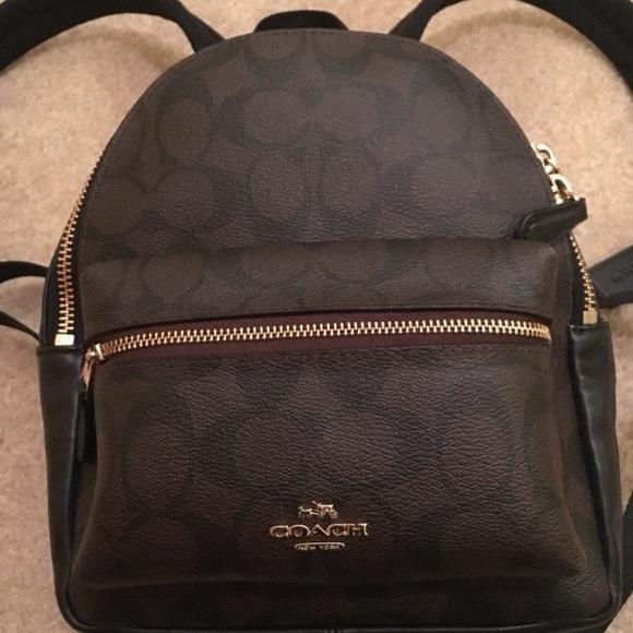 9734a28991e4 Coach Handbags - Coach Signature Mini Charlie Backpack